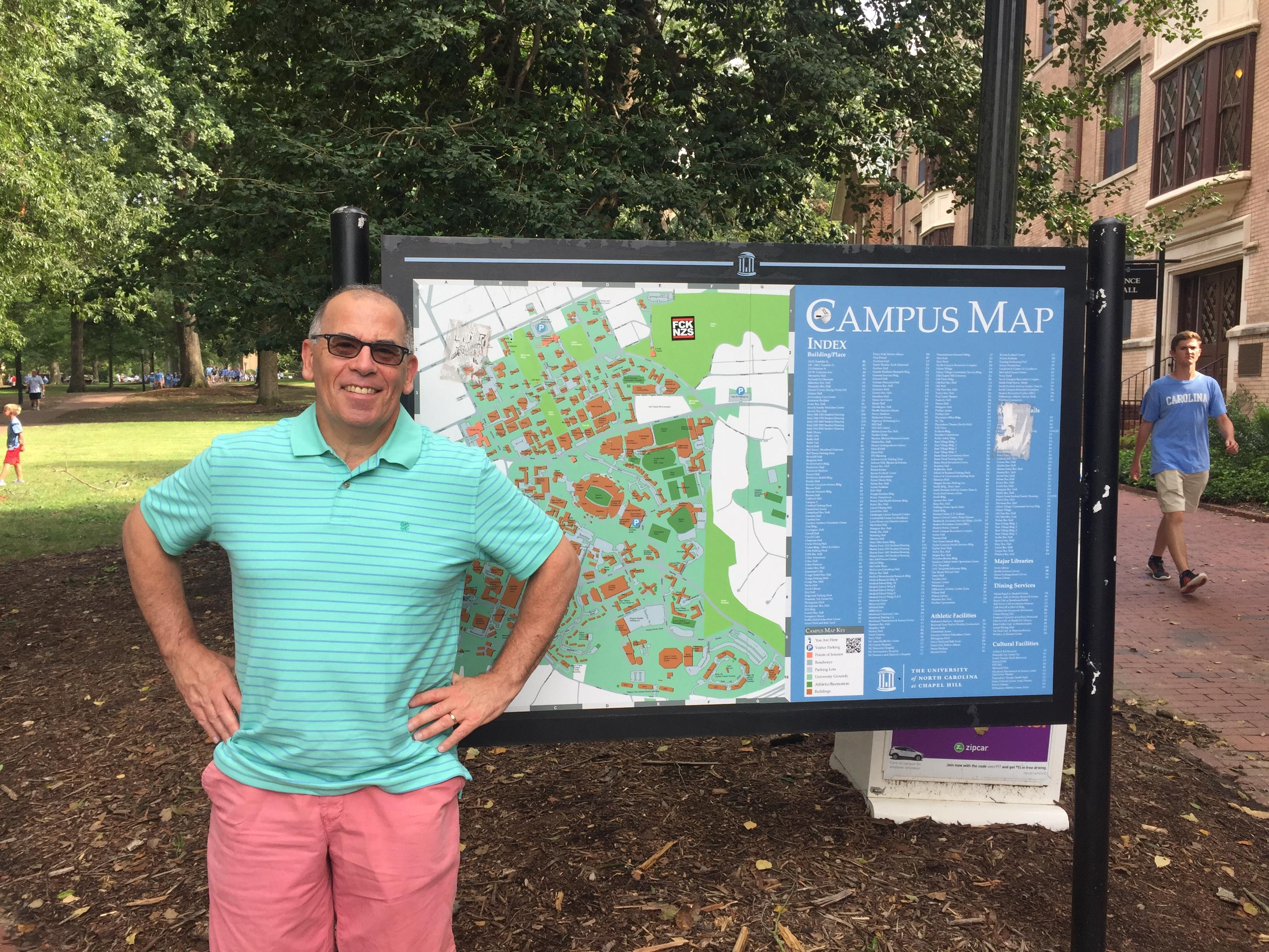 Neal in front of Campus Map
