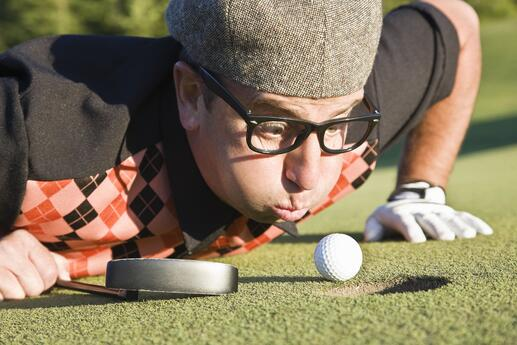 golfer-blowing-ball-into-hole-56a3d6635f9b58b7d0d406e8